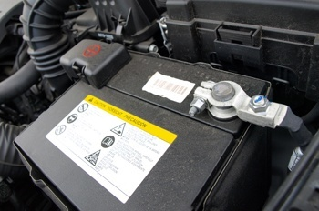 How do I make sure my car battery has a good electrical connection?